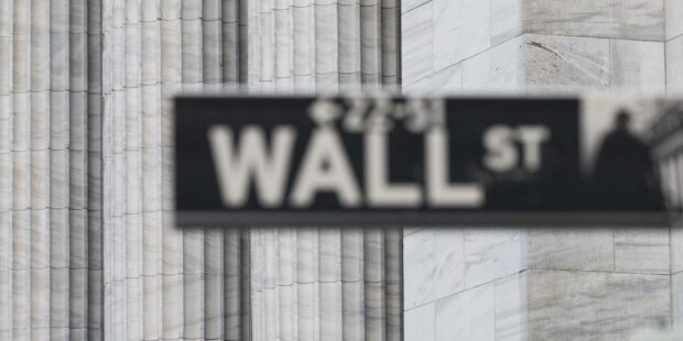 Dow lower by 240 points as hectic week in earnings, data and politics winds down
