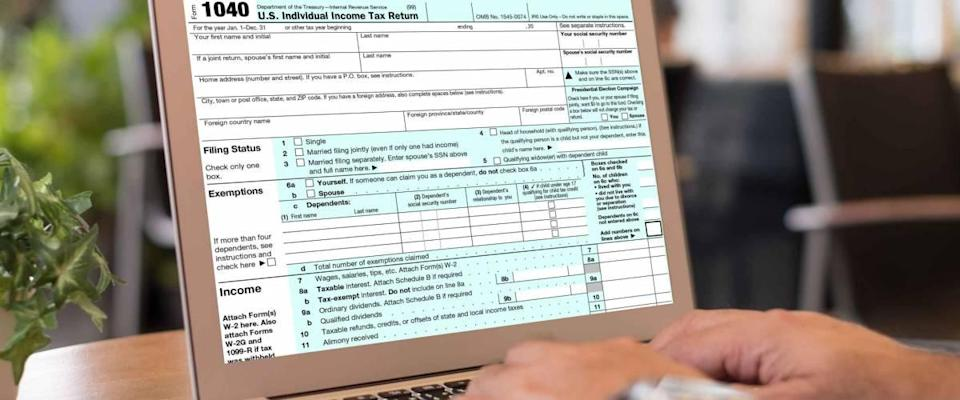 taxes payment concept. accountant are filling Individual income tax return forms online on screen laptop computer.