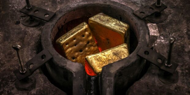 Gold drops nearly 5% after Fed ups inflation forecasts but signals higher interest rates