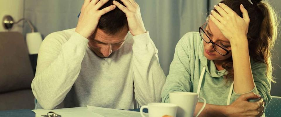 Middle-aged family having difficulties with paying utility bills and rent