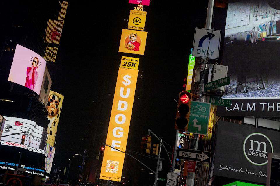 NEW YORK, NEW YORK - JULY 20: A billboard in Times Square displays signs for Dogecoin on July 20, 2021 in New York City. New York City has seen a slow increase of tourism as more people receive the COVID-19 vaccination. The Times Square Alliance reported more than 160,000 tourists in early April 2021, which is a five time increase from the same time the previous year. (Photo by Alexi Rosenfeld/Getty Images)