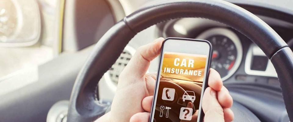 Driver looking at car insurance website on smartphone