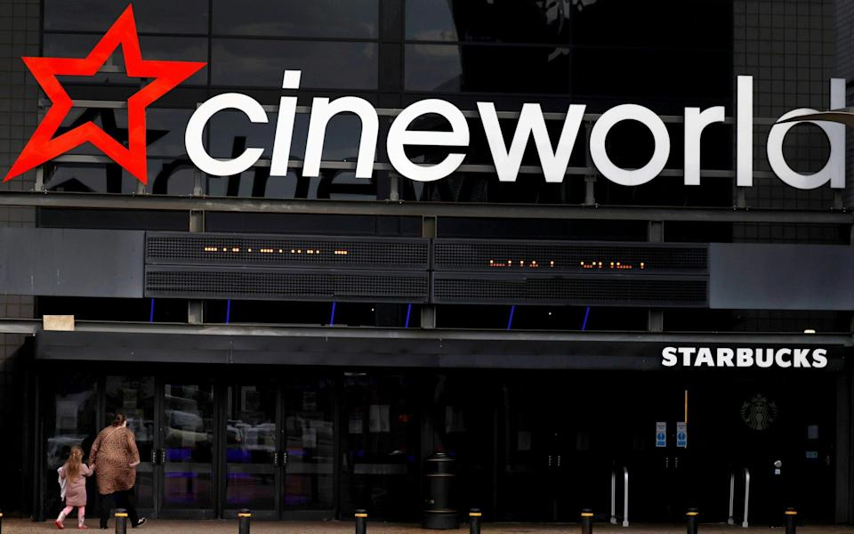 People enter a Cineworld cinema near Manchester - Phil Noble/Reuters